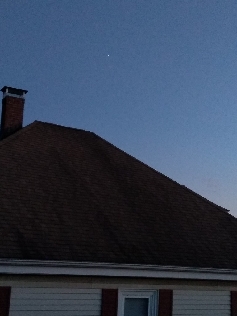 Jupiter at twilight above roof