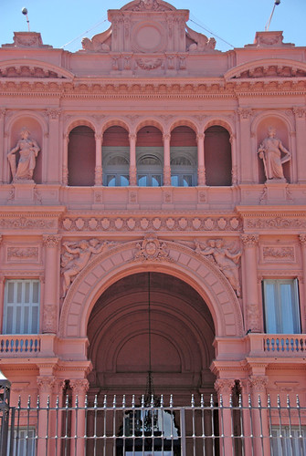 Arches define the gracious entrance as well as the balconies where Eva Peron used to stand and give her speeches (Casa Rosada in Buenos Aires, Argentina)