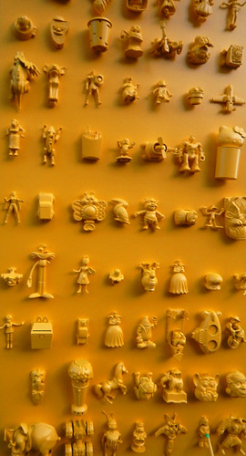 Details of the collage of small objects on the golden arches of a Macdonalds in Copenhagen, Denmark