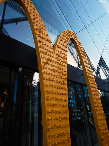 A collage of small objects on the golden arches of a Macdonalds in Copenhagen, Denmark