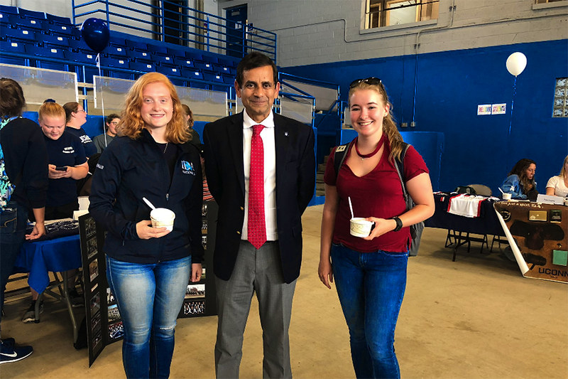 Dean Chaubey with two students at the UConn Animal Science welcome event.
