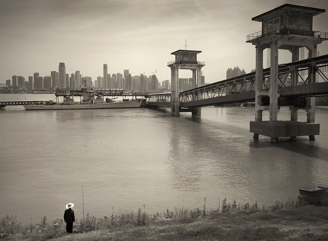TIME STOOD STILL WHILE WAITING PATIENTLY ON THE BANK OF THE MIGHTY YANGTZE RIVER (Wuhan, China) --- the military sitting quietly between urban prosperity and envious rural communities.