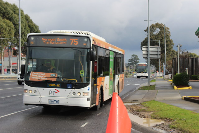 Route 75 tram replacement bus in front of route 732 bus on Burwood Highway, Burwood East