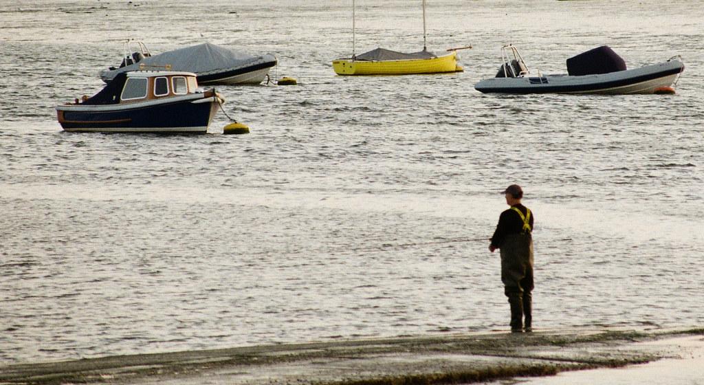 Man Fishing Bosham Harbour, West Sussex UK