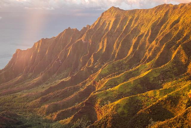 Kalalau Valley in Nā Pali Coast State Park, Kauai, Hawaii at sunset.