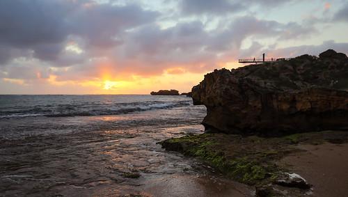 sunset sun rocks limestone cape peron point water sea gold