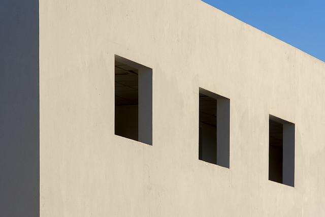 Empty building with three windows