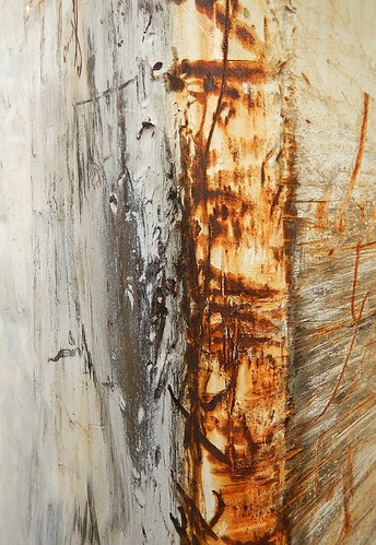 Abstract formed from scrapes on a rusty dumpster