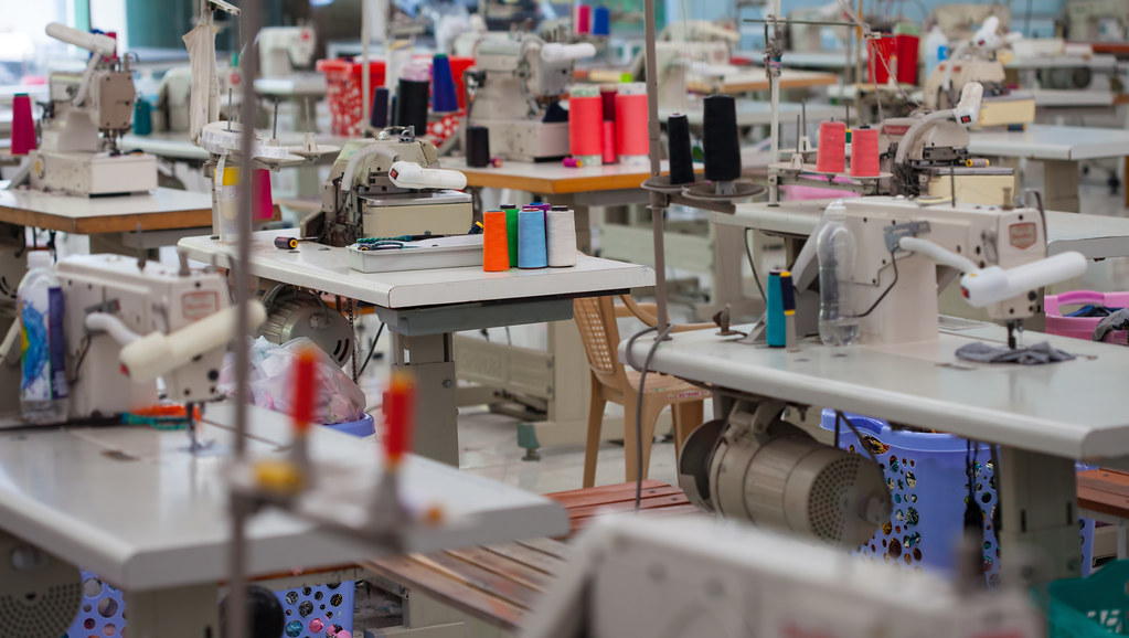 Image of clothing being made in a factory.