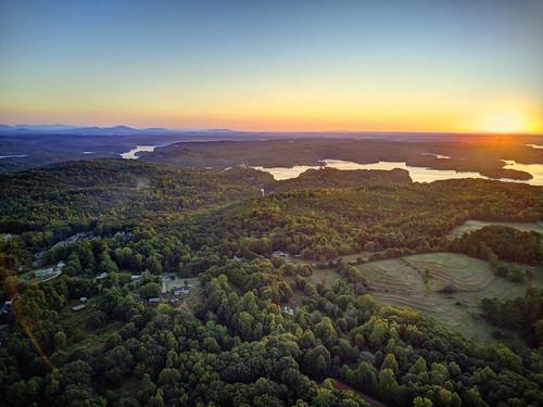 ronmayhew dji lakelanier yonah mountaingeorgianorth georgiasunriseforsyth county aerial drone sky water pasture sun
