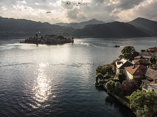 andreamoscato italia montagna landscape light luce paesaggio sky shadow cielo clouds nature natura nuvole natural naturale view vista vivid day panorama lago lake water freshwater ombre yellow mountain island isola city città boat piemonte convento orange church chiesa house architecture architettura art overlook fly drone dji mavic air quadcopter blue dark deep sunset dusk evening reflection riflesso waves