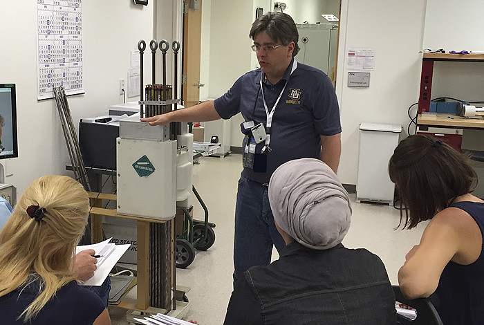 Los Alamos scientist Peter Santi (currently on a long-term assignment with the International Atomic Energy Agency) trains a group of aspiring nuclear inspectors.
