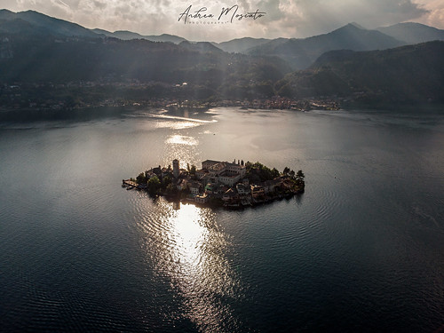 andreamoscato italia montagna landscape light luce paesaggio sky shadow cielo clouds nature natura nuvole natural naturale view vista vivid day panorama lago lake water freshwater ombre yellow mountain island isola city città boat piemonte convento orange church chiesa house architecture architettura art overlook fly drone dji mavic air quadcopter blue dark deep sunset dusk evening reflection riflesso waves ray sun