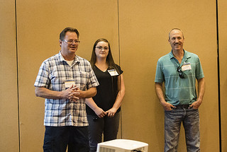 Employees from LANL talk to candidates about life at the Laboratory during the hiring event August 28.