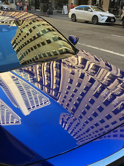 Reflections on a blue car