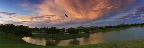 indianschoolpark sunset scenicview sky pond ducks americanflag clouds grass goldensky pinksky green blue pink orange gold yellow water publicpark phoenixarizona phoenixariz phoenixaz phoenix dearflickrfriend jimhankey