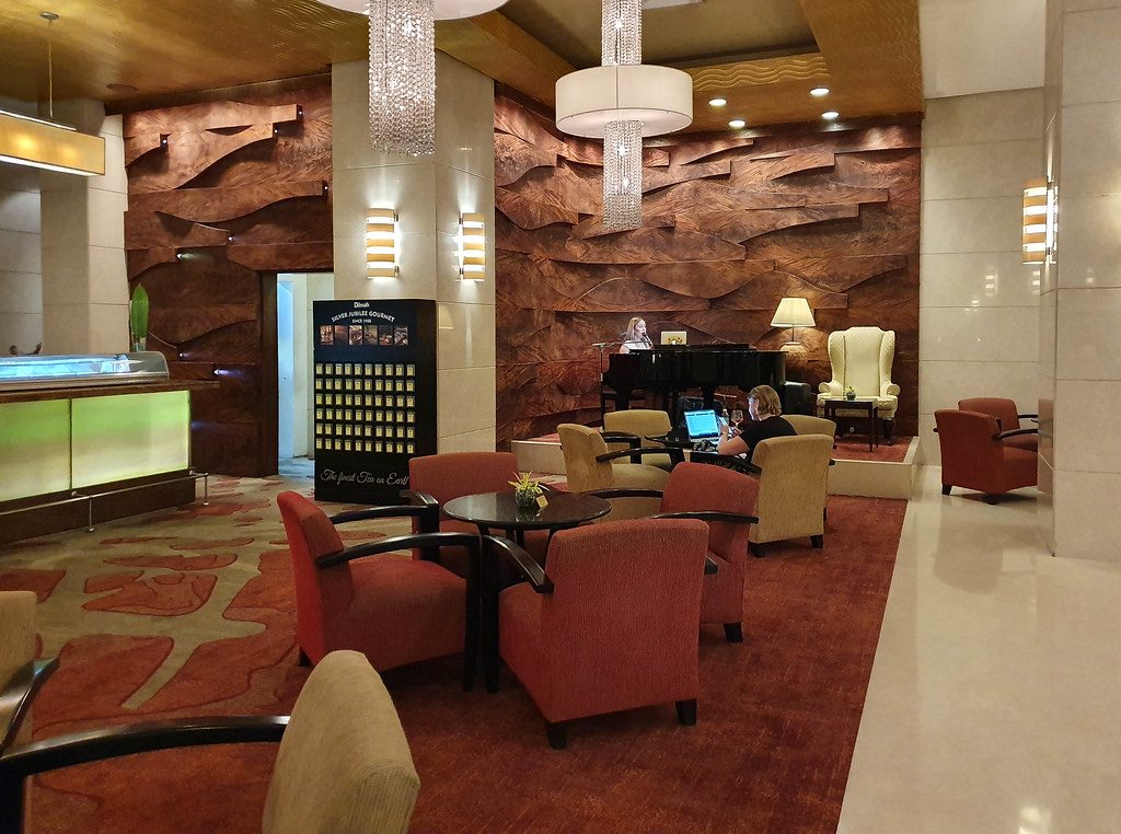 The lobby lounge with a singer playing the piano