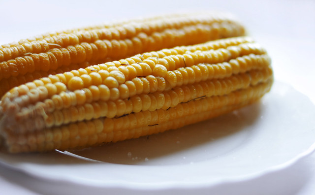 Double sweet corn on the plate  on white background