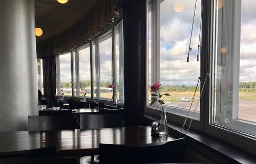 airport vintage helsinki malmi finland restaurant view window plane sky clouds table chair flower empty