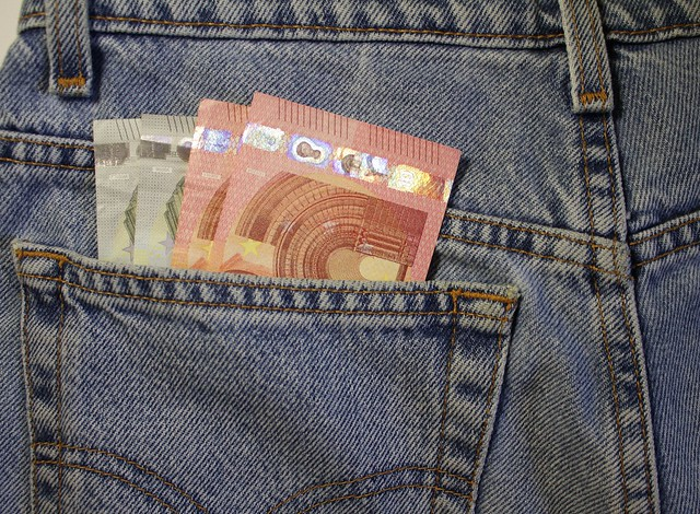 A few euro stick out of my pocket. Paper money is in a ji-pocket. Cash bills are stored in a jeans pocket. Pocket money for small expenses
