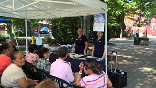 Heather Peracchio, left, and Julianne Restrepo Marin give a nutrition class in English and Spanish at the Danbury Farmers' Market. (Sara Putnam/UConn Photo)