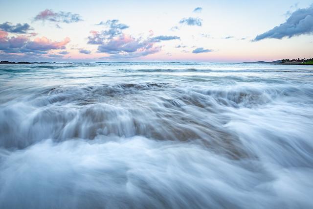 Waves and rocks at dawn, Kauai, Hawaii