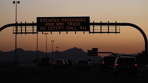 freewaysign arizona fugitive escape dusk mesaarizona us60 sunset