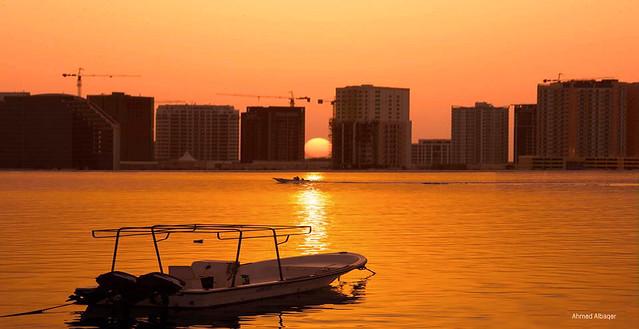 Orange sea sunrise شروق خلف الأمواج