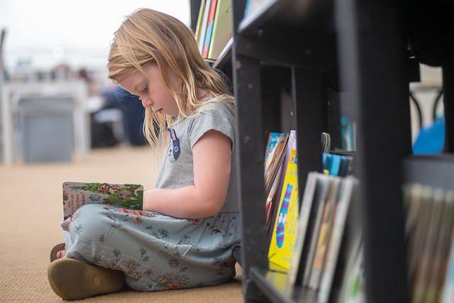 Little girl reading in the Bookshop