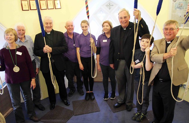Julia Lysaght, Cyril Galbraith, Archbishop Michael Jackson, Brian McCann, Helen Little, Canon Robert Warren and the Revd Nigel Pierpoint with Taney's next generation of young bell ringers at the inauguarl Galbraith Cup competition.