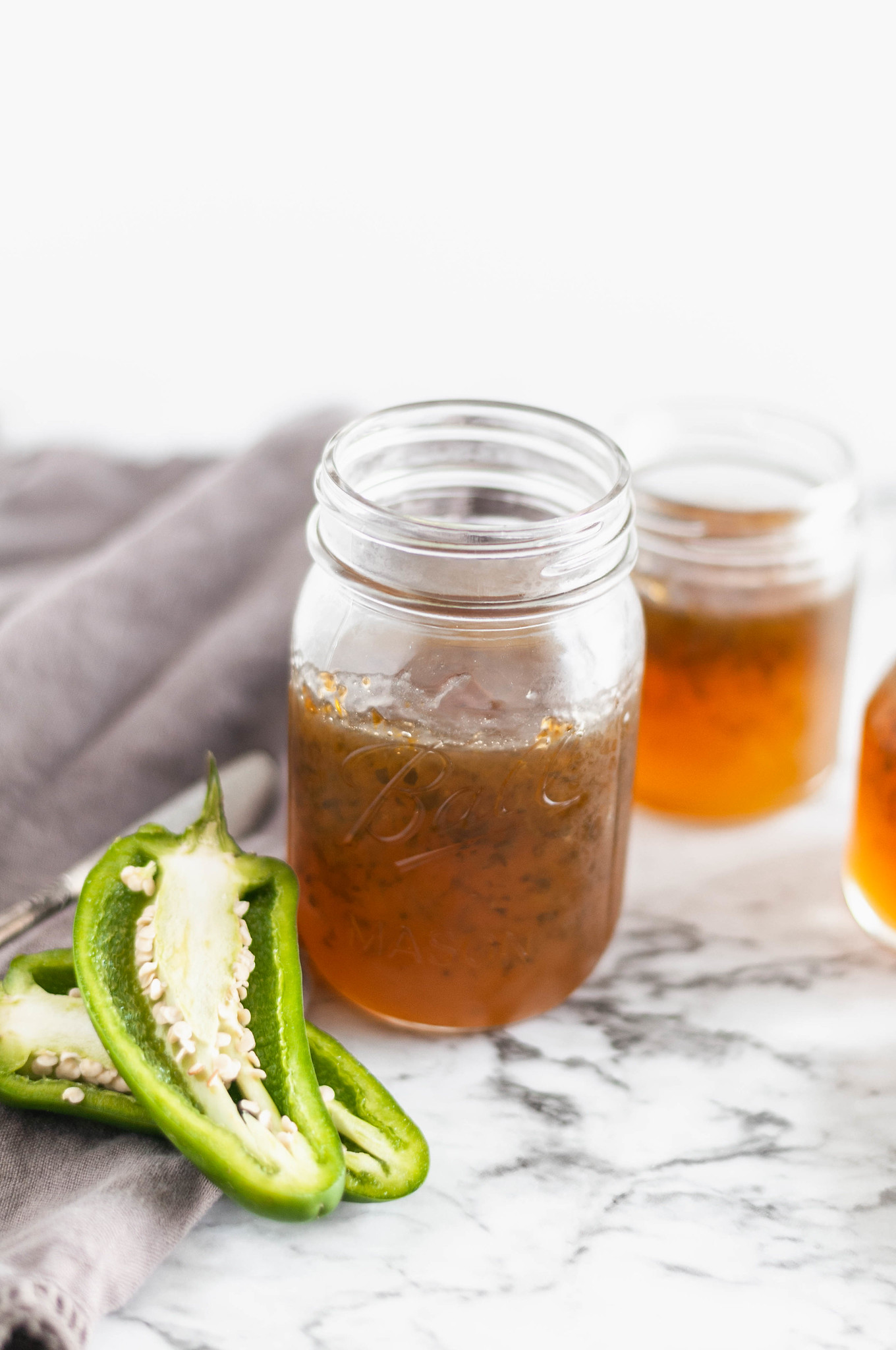 Homemade Jalapeno Jelly is easier than you would think and so delicious on all the things. Slather it on hot cornbread, a juicy burger or use it as a dip.