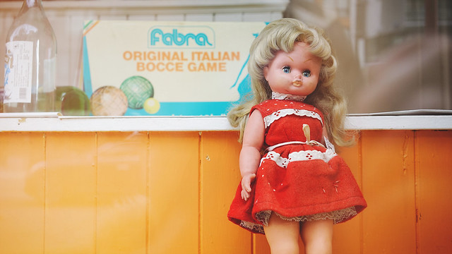 Creepy doll in store window