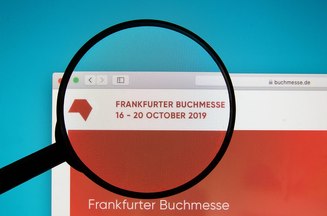 Frankfurter Buchmesse website on a computer screen with a magnifying glass