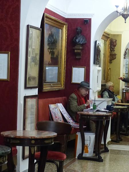 peintre au café greco