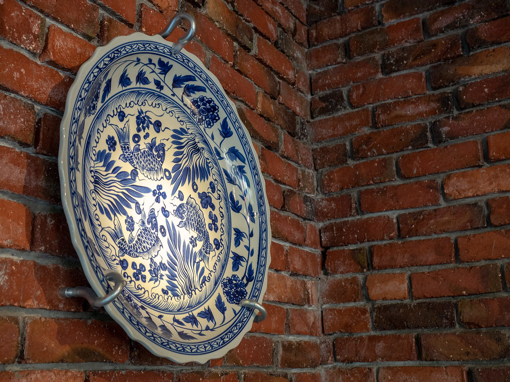 A big ceramic plate as decoration on the wall.