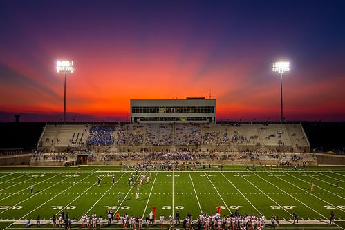 sunset stadium orange blue sky football game hs high school band people canon 5d3 tx austin texas