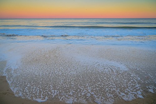 virginiabeach virginia unitedstates the beach sunset over atlantic ocean va us usa water sand coast shoreline coastline colors colours orange pink yellow surf sea
