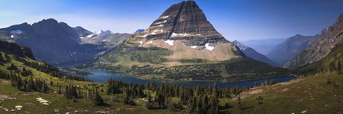 glacier mountain park national nature outdoors hiking blue green lodgepole pine water lake hidden snow summer camping landscape