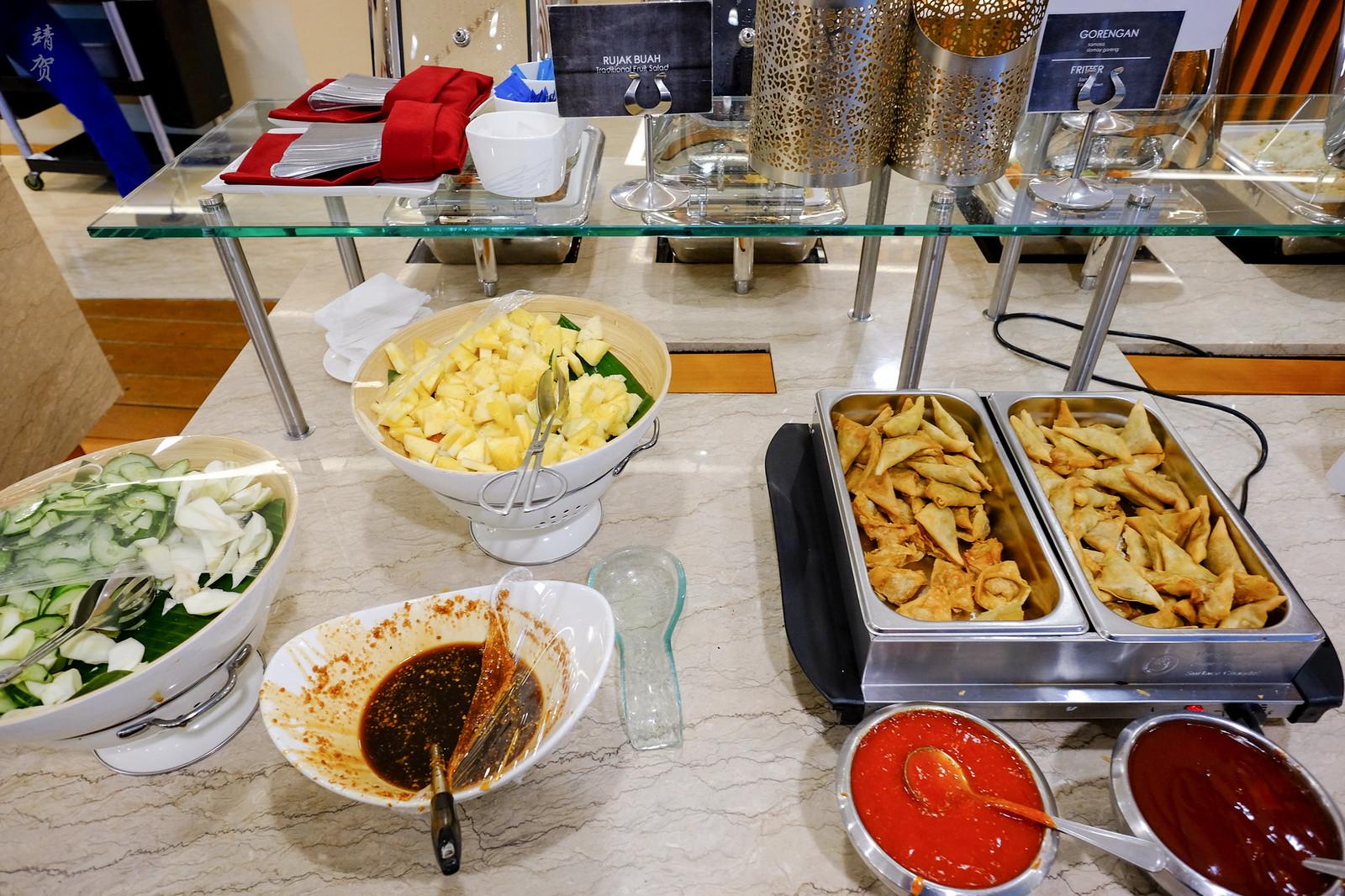 Fried snacks and fruit salad