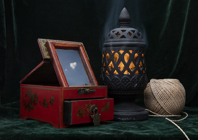 Still life with a Chinese jewelry box, an incense burner and a ball of twine