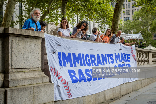 Rise And Resist IMMIGRANTS MAKE BASEBALL GREAT banner drop