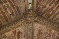 south porch boss: angel with a banner