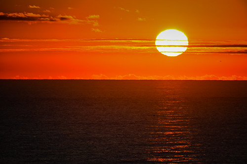 virginiabeach virginia unitedstates sunrise over atlantic ocean beach va water us usa sea orange sun full yellow