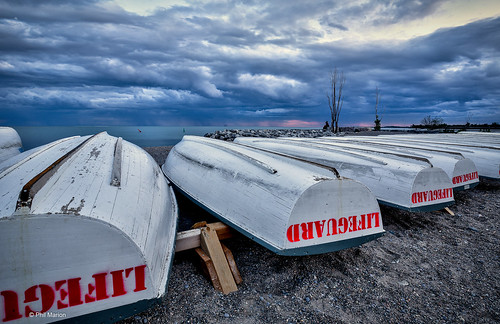 Ominous clouds over lifeguard rowboats - Kew Beach, Toronto | by Phil Marion (176 million views - THANKS)