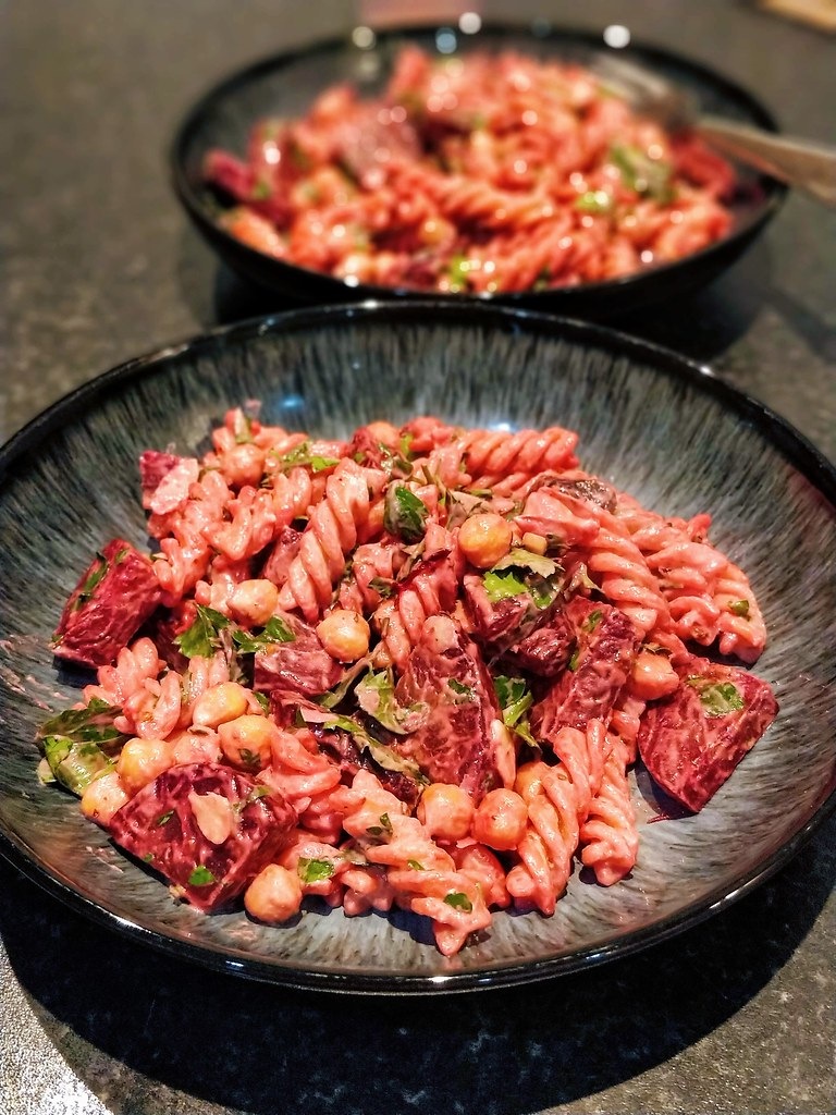 Beetroot & chickpea pasta with a lemon tahini sauce in bowls