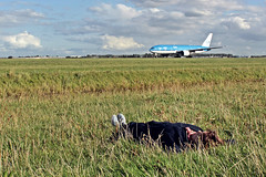 Amsterdam Schiphol Airport: Lying in the grass near airplanes in Take Off