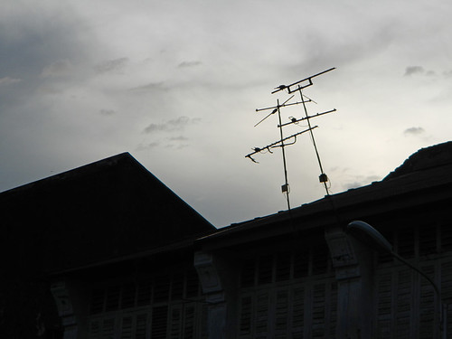 Silhouette of a building sprouting two TV antennas in Penang, Malaysia