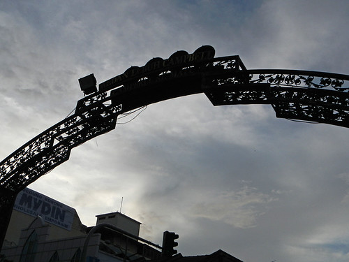 Silhouette of a gate against a dark sky in Penang, Malaysia