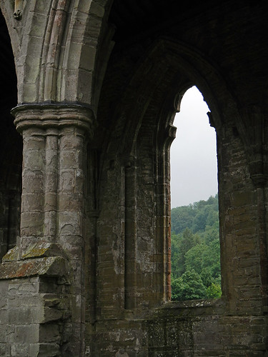View through the arched window at the Tintern Abbey Ruins in Wales