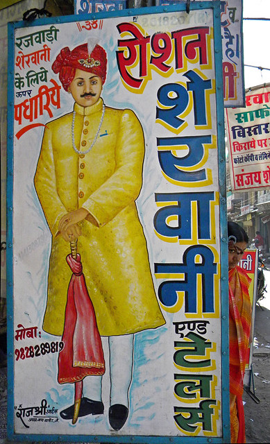 A sign featuring the clothing of a well-dressed gentleman in Jodhpur, India
